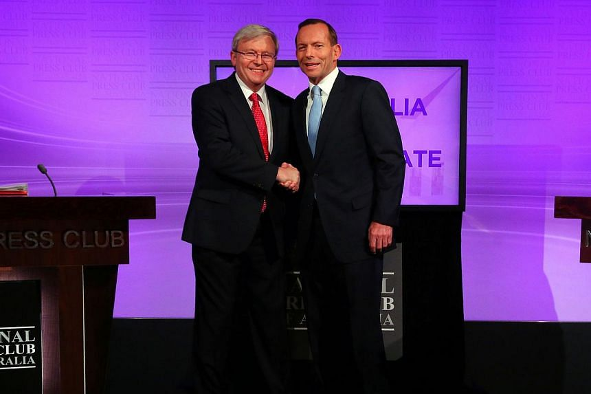 Australian Prime Minister Kevin Rudd shakes hands with conservative opposition leader Tony Abbott at the National Press Club in Canberra before a debate on Aug 11, 2013. Australia's conservatives led by Tony Abbott are maintaining an election-winning