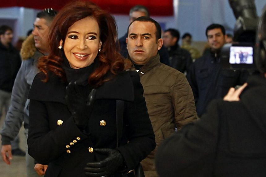 Argentine President Cristina Fernandez leaves after casting her vote at a polling station in the Patagonian city of Rio Gallegos on Aug 11, 2013. -- PHOTO: REUTERS