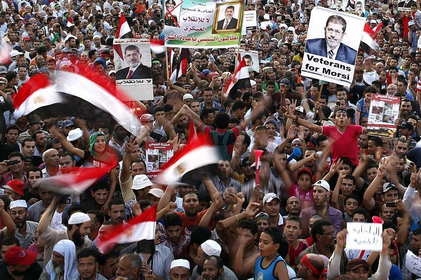 Members of the Muslim Brotherhood and supporters of deposed Egyptian President Mohamed Mursi chant slogans at Rabaa Adawiya Square, where they are camping in the Nasr city area, east of Cairo August 11, 2013.Supporters of ousted Egyptian presid