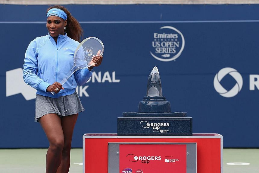 Serena Williams holds the winner's trophy after her win over Sorana Cirstea of Romania during the finals of Rogers Cup Toronto at Rexall Centre at York University on Aug 11, 2013 in Toronto, Canada. Williams made it look easy Sunday, routing Cirstea