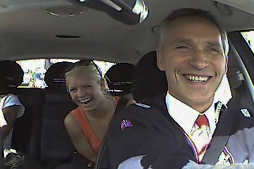 In this undated photo taken from video, provided by the Norwegian Labour Party, Norwegian Prime Minister Jens Stoltenberg, takes the role of a taxi driver in Oslo, Norway, as a part of the election campaign for Norwegian Labour Party. Mr Stoltenberg