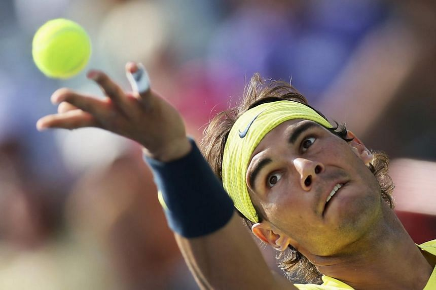 Rafael Nadal of Spain serves to Milos Raonic of Canada during the men's finals match at the Rogers Cup tennis tournament in Montreal, Aug 11, 2013. Spain's Rafael Nadal took just 68 minutes to deliver a body-blow to Canada's biggest tennis week