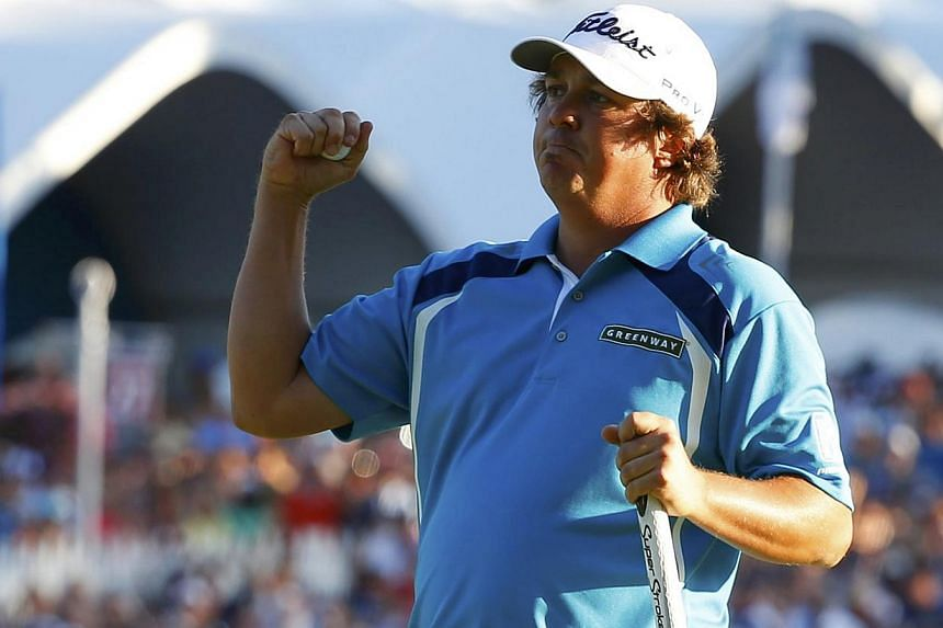 Jason Dufner of the US reacts as he wins the 2013 PGA Championship golf tournament on the 18th green at Oak Hill Country Club in Rochester, New York on Aug 11, 2013. Dufner won his first major title at the 95th PGA Championship, seizing an early lead