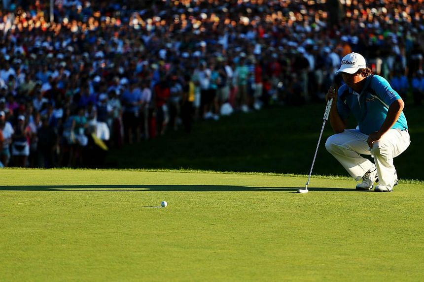 Jason Dufner of the United States lines up his putt on the 18th green during the final round of the 95th PGA Championship on Aug 11, 2013 in Rochester, New York. -- PHOTO: AFP