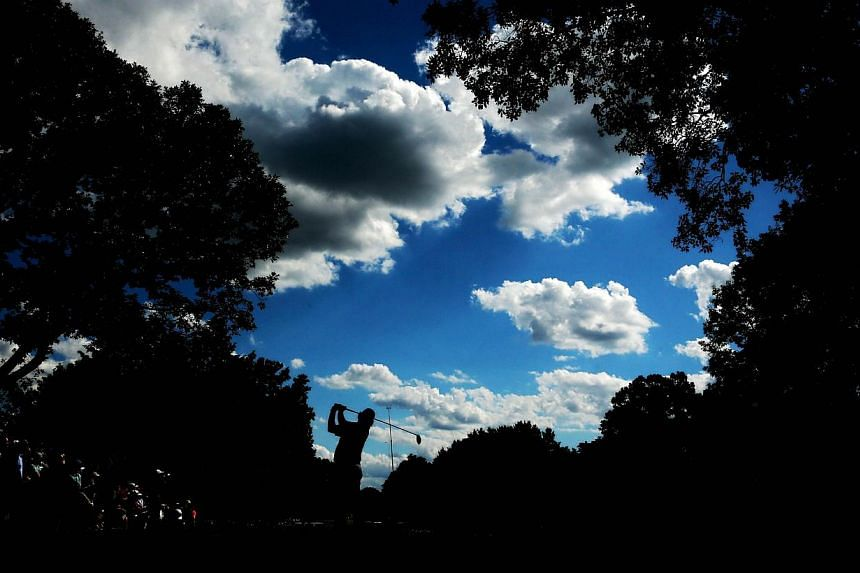 Jason Dufner of the United States hits his tee shot on the eighth hole during the final round of the 95th PGA Championship on Aug 11, 2013 in Rochester, New York. -- PHOTO: AFP