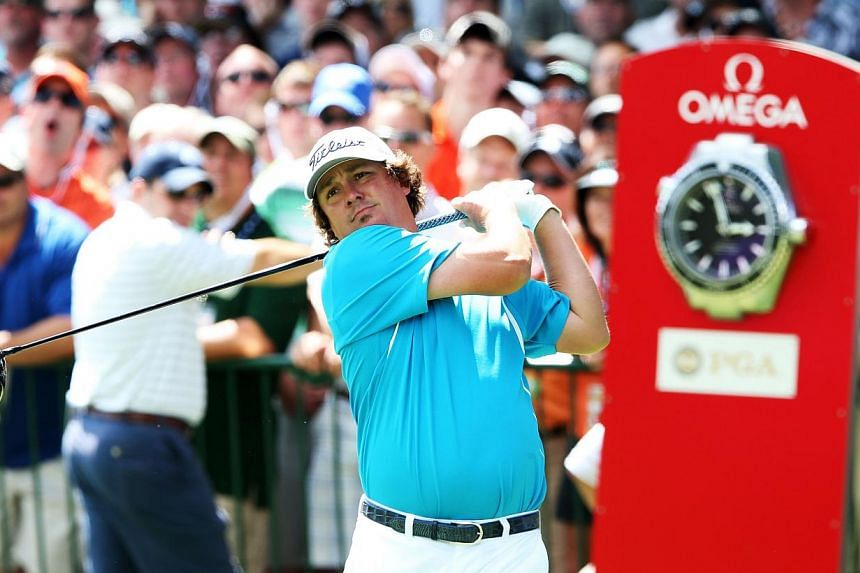Jason Dufner of the United States hits his tee shot on the first hole during the final round of the 95th PGA Championship on Aug 11, 2013 in Rochester, New York. -- PHOTO: AFP