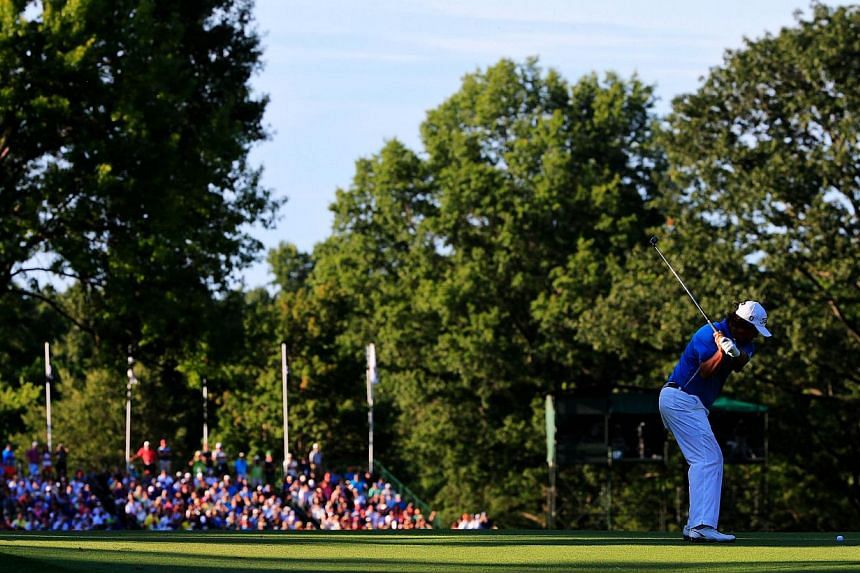 Jason Dufner of the United States hits an approach shot on the 17th fairway during the final round of the 95th PGA Championship on Aug 11, 2013 in Rochester, New York. -- PHOTO: AFP