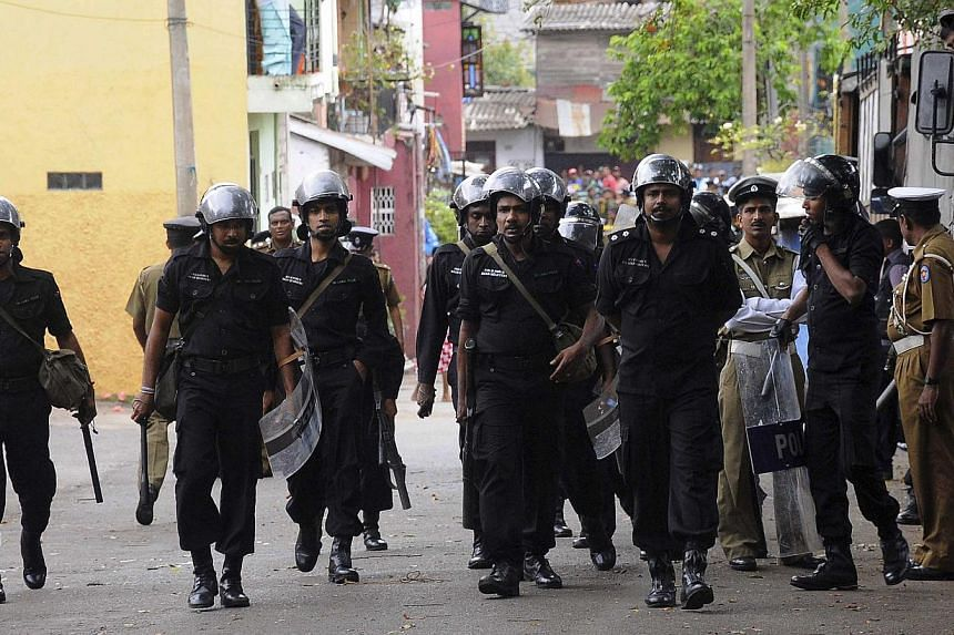 Sri Lanka's riot police patrol outside a vandalised mosque in Colombo on Aug 11,2013. Sri Lanka's Muslim leaders closed down a new mosque in Colombo on Monday after attacks by a Buddhist mob revived simmering religious tensions and sparked US concern