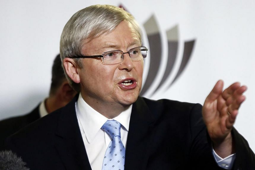 """Australian Prime Minister Kevin Rudd speaks during a news conference after visiting the facilities of Macquarie University as part of his election campaign in Sydney on Aug 12, 2013. Mr Rudd said on Monday it was time to end the """"acrimonious"""" debate"""