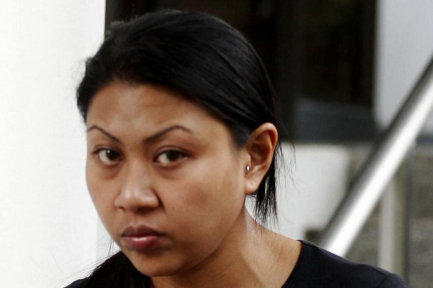 Siti Nurazlin Samat, 28, pleaded guilty to sending nude photos of a female teacher to her school in a bid to get her into trouble. -- ST PHOTO: WONG KWAI CHOW