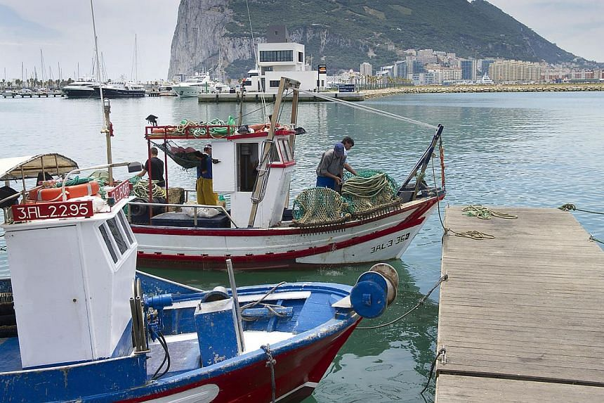 Spanish fishing boats sit moored in La Linea de Concepcion, Spain, in front of Gibraltar on May 28, 2012. The British government is considering taking legal action against Spain over stringent border checks imposed at the border with Gibraltar, a spo