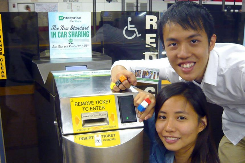 """SUTD students Olivia Seow and Edward Tiong showing how their """"Sesame Ring"""" works at a subway station in Boston."""