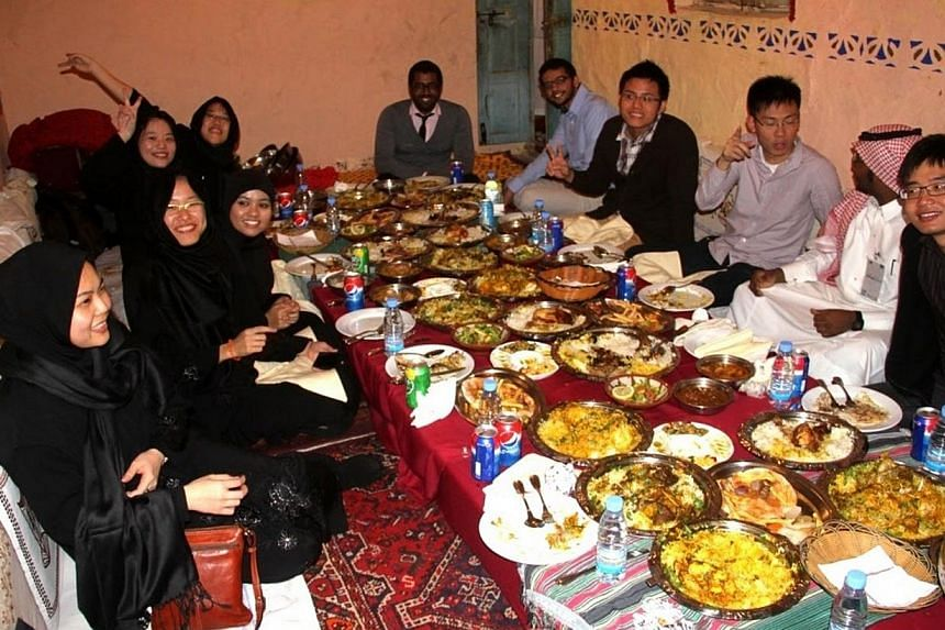 NUS students dining with faculty staff and students of the King Fahd University of Petroleum and Minerals in Dammam, Saudi Arabia, last year. Over 60 per cent of NUS undergraduates now take part in overseas programmes.