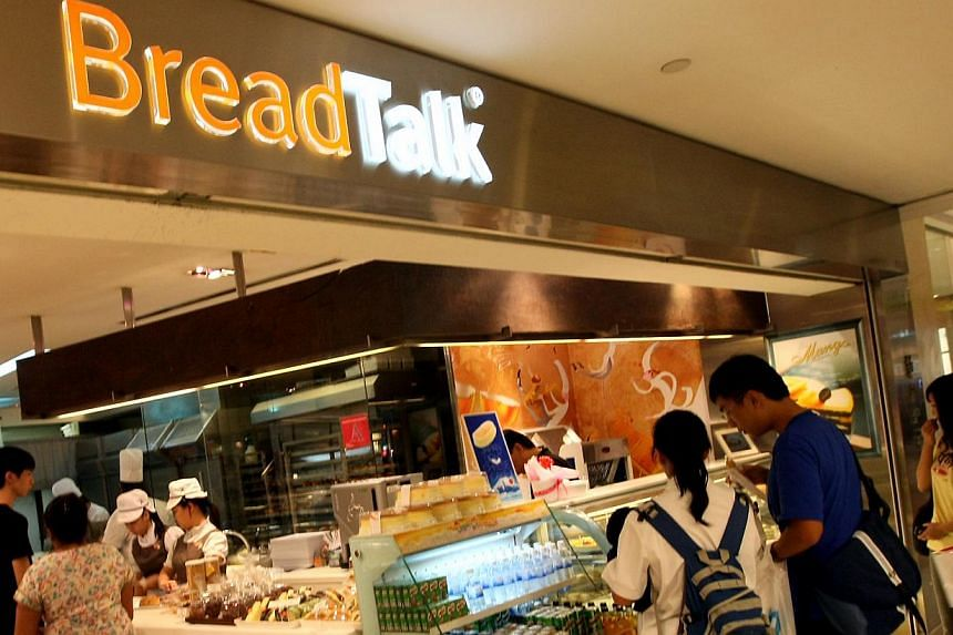 Customers at one of the BreadTalk outlet in Singapore, which served a selection of pastries. BreadTalk Group has reported flat second quarter net earnings of $3 million even as revenue grew at a fast clip of 20.7 per cent to $126.5 million. -- NP FIL
