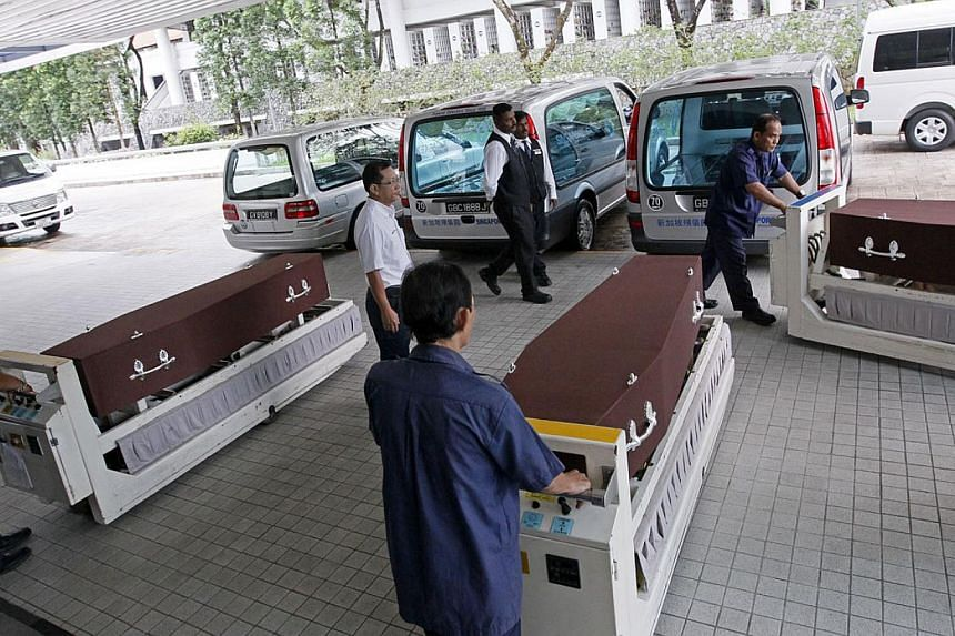 The funeral service for the Korean victims of the CTE crash was held on Monday, Aug 12, 2013. -- ST PHOTO: MARK CHEONG