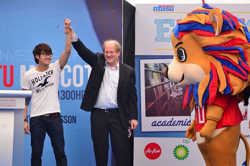 Nanyang Technological University (NTU) president Bertil Andersson (centre) congratulates final-year computer science student Chia Yan An (left), who designed Lyon (right), NTU's first mascot.-- PHOTO: NTU