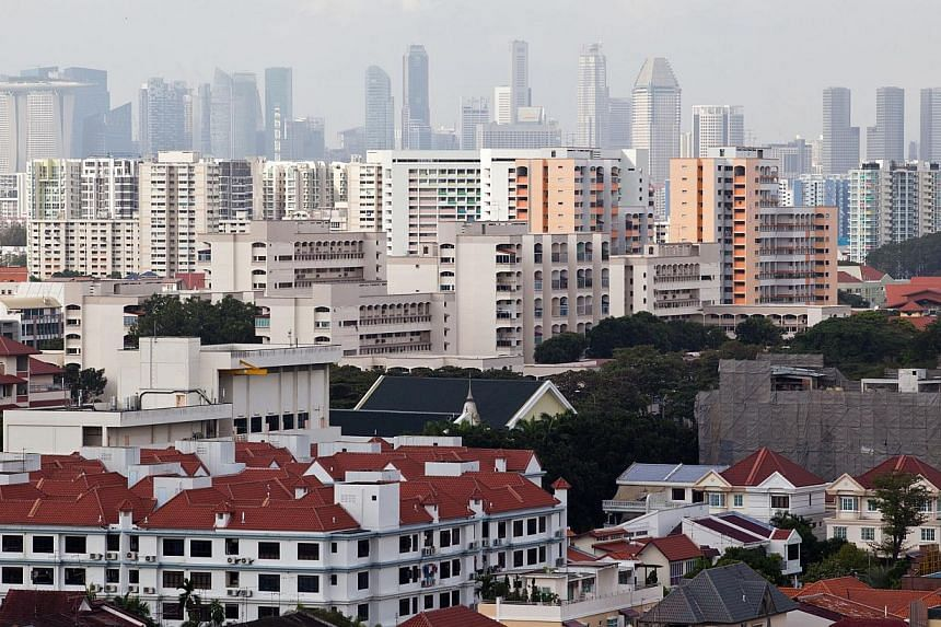 Singaporean households are overall in good financial shape and even those who may have over-stretched themselves are unlikely to default on their loans even when interest rates rise. -- FILE PHOTO: BLOOMBERG