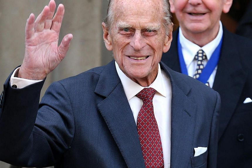 Queen Elizabeth II's 92-year-old husband Prince Philip returned to public duties on Monday, conducting his first engagement since undergoing abdominal surgery in June. -- PHOTO: REUTERS