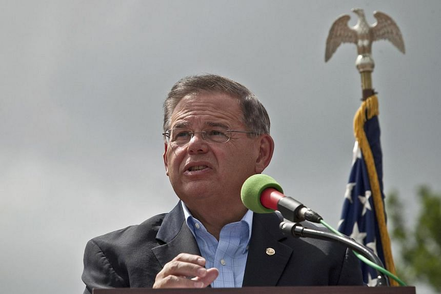 US Sen. Robert Menendez (D-NJ) speaks at the reopening ceremony of the Statue of Liberty on the first day it is open to the public after Hurricane Sandy on July 4, 2013 on the Liberty Island in New York City. A top United States (US) senator headed o