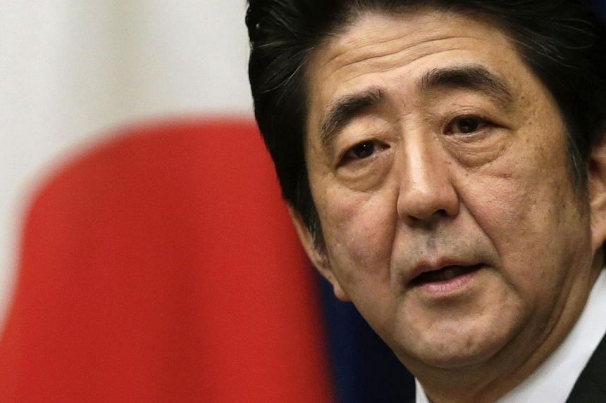Japan's Prime Minister Shinzo Abe speaks during a news conference at his official residence in Tokyo in this March 15, 2013 file photo.Mr Abe is considering a corporate tax cut as a way to offset the potential economic drag of a planned two-stage hik