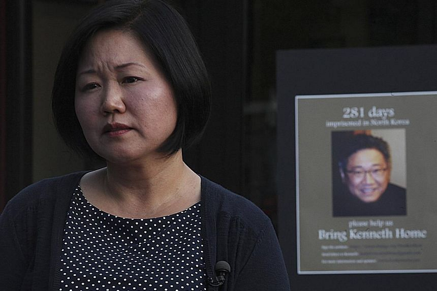 Terri Chung, sister of Kenneth Bae, looks on during a vigil for Bae in Seattle, Washington in this August 10, 2013 file photo. The United States on Monday urged North Korea to free a jailed US citizen, warning that his health was deteriorating. -- FI