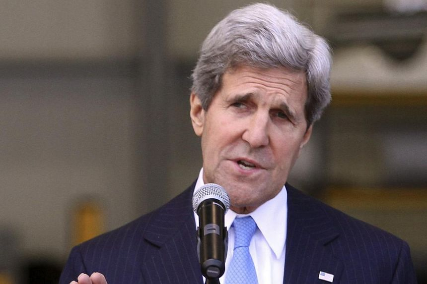 """United States Secretary of State John Kerry speaks during a news conference at the anti-narcotics department of Colombia in Bogota on Aug 12, 2013. Mr Kerry urged Palestinians """"not to react adversely"""" to Israel's announcement of new settlement buildi"""