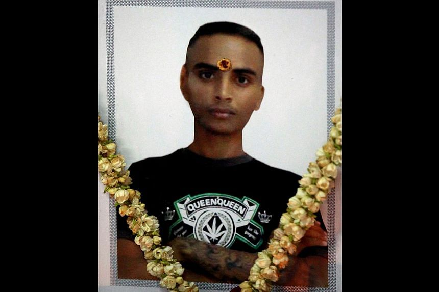 Dinesh, 21, was found to have died from breathing difficulties after he was placed chest down on the ground in an isolation cell. -- TNP FILE PHOTO