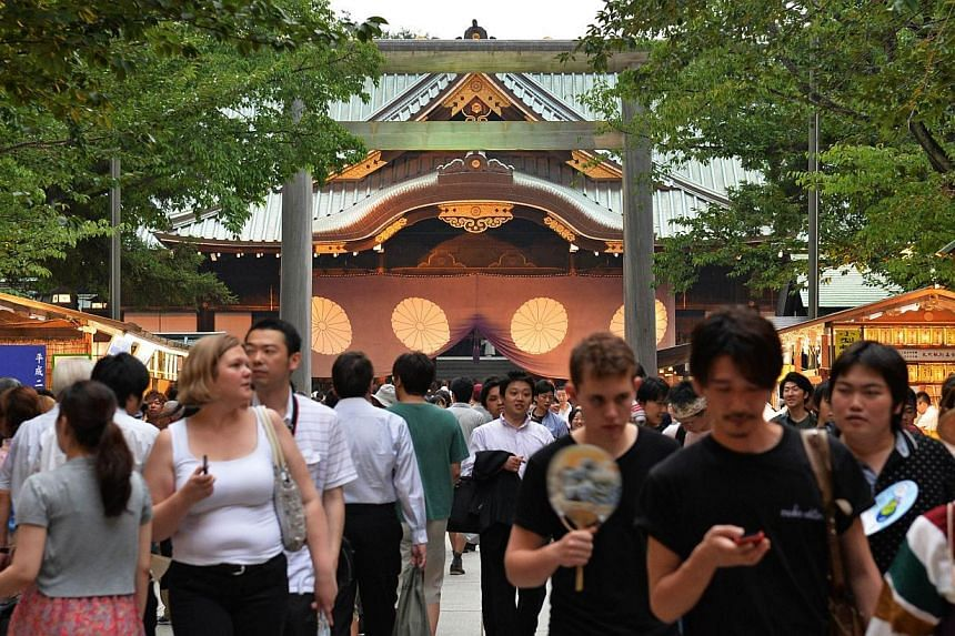 People visit the Yasukuni Shrine during the Mitama Matsuri festival in Tokyo on July 13, 2013. Japanese Prime Minister Shinzo Abe may make a ritual offering to a shrine seen as a symbol of Japan's former militarism, the media said on Wednesday - a mo