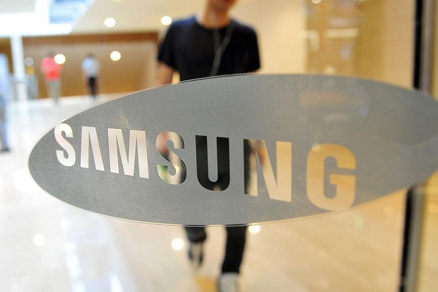 A South Korean man walks past a Samsung Electronics logo displayed at the company's main building in Seoul on July 26, 2013. Brazil has filed a lawsuit against Samsung alleging poor working conditions at a factory in the Amazon and demanding more tha