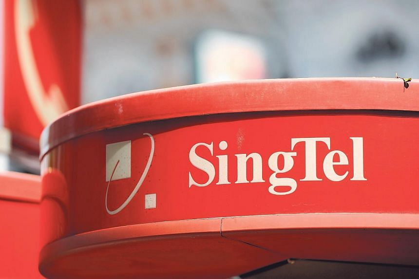 The SingTel logo is displayed atop of one of the company's public payphone kiosks in Singapore, on Wednesday, Nov 9, 2011. South-east Asia's largest telecommunications operator Singapore Telecommunications Ltd reported a 7 per cent rise in first-quar