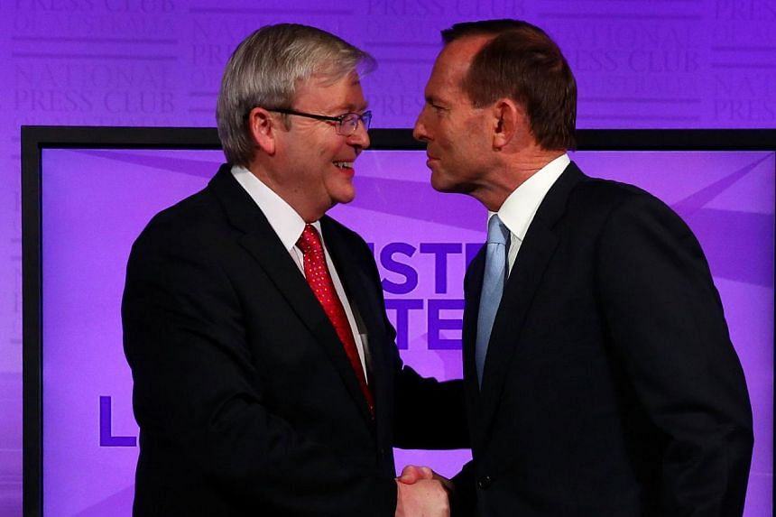 """Australian Prime Minister Kevin Rudd talks with conservative opposition leader Tony Abbott at the National Press Club in Canberra before a debate on Aug 11, 2013. Mr Rudd on Wednesday said there was """"no place"""" for sexism, racism or homophobia in Aust"""