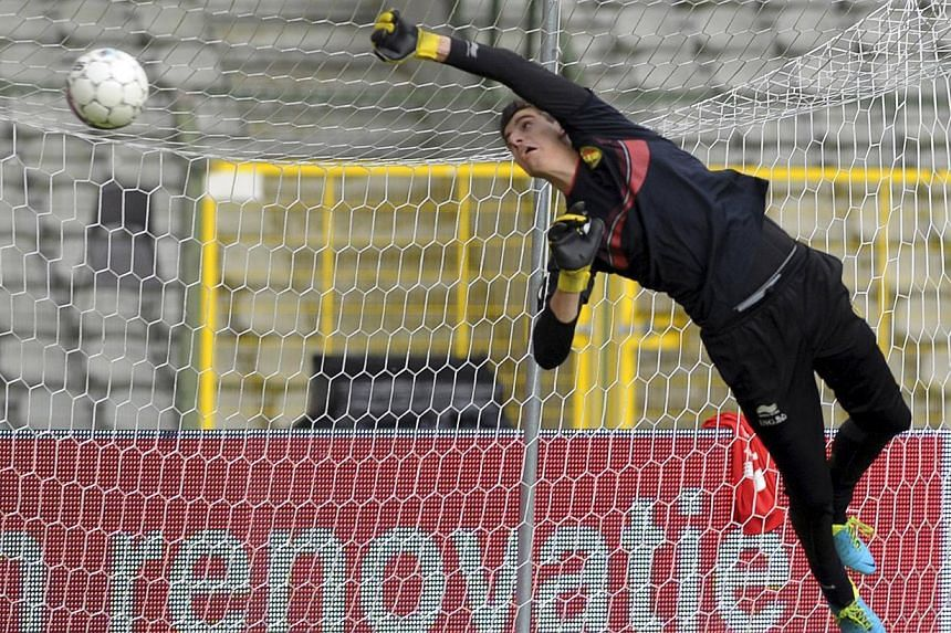 Goalkeeper Thibaut Courtois saves a ball during a training session at the King Baudouin stadium in Brussels on Aug 13, 2013. -- PHOTO: REUTERS