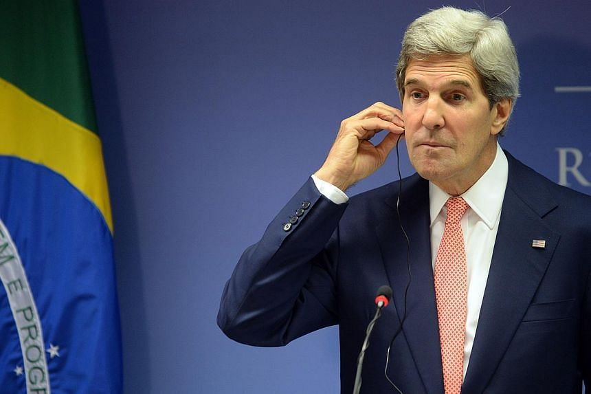 US Secretary of State John Kerry adjusts his earphone during a joint press conference with Brazil's Foreign Minister Antonio Patriota at Itamary Palace in Brasilia, Brazil, on Tuesday, Aug. 13, 2013. Brazil warned Mr Kerry on Tuesday that failure to