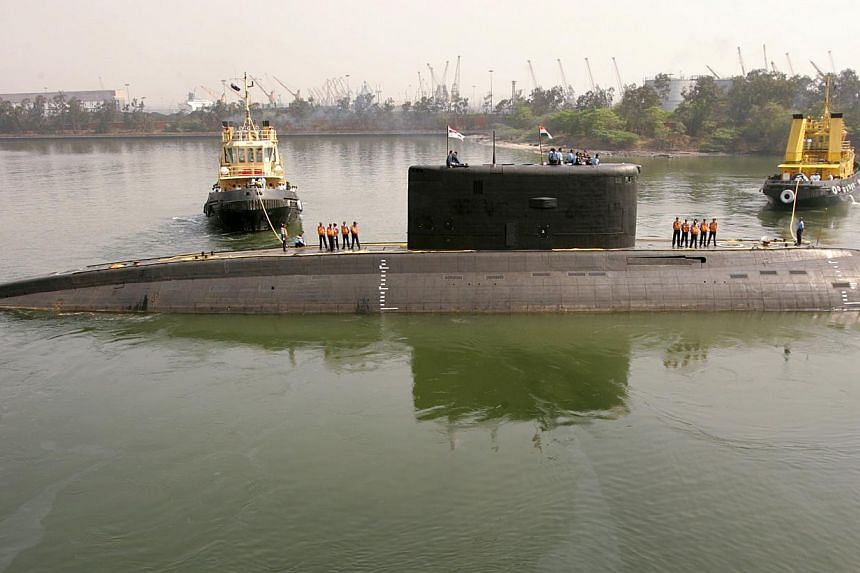 The Indian Navy's Sindhurakshak submarine is seen in Visakhapatnam on Feb 13, 2006. About 18 Indian sailors were trapped after an explosion and fire on board the Sindhurakshak, a conventionally powered Indian submarine, berthed at the coastal city of
