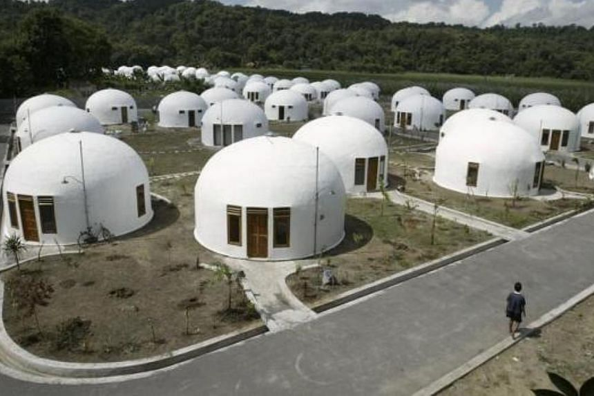 A view of about 70 domes houses, which were built by US based Domes for the World, for villagers who lost their houses to an earthquake in Sumberharjo village, near Indonesia's ancient city of Yogyakarta on May 8, 2007. -- FILE PHOTO: REUTERS