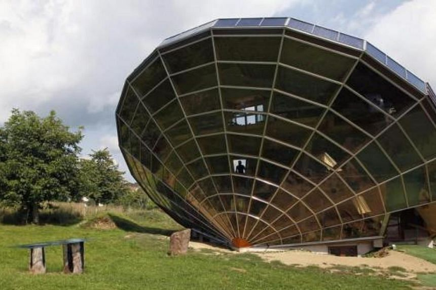 The Heliodome, a bioclimatic solar house is seen in Cosswiller in the Alsacian countryside near Strasbourg, eastern France on Aug 4, 2011. The house is designed as a giant three-dimensional sundial, set on a fixed angle in relationship to the sun's m