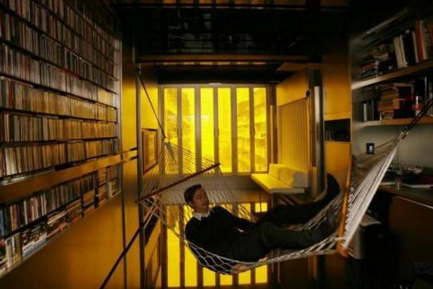 Hong Kong architect Gary Chang rests in a hammock inside his 32 sq m apartment in Hong Kong on Jan 28, 2010. After three decades in the same boxy dwelling Mr Chang grew up in, he has come up with an innovative answer to the increasingly cramped lives