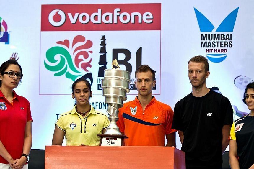 India's Jwala Gutta of Delhi Smashers (from left), India's Saina Nehwal of Hyderabad Hotshots, Germany's Mark Zweibler of Mumbai Masters, Denmark's Carsten Mogensen of Banga Beats and India's Ashwini Ponappa of Pune Pistons pose with the IBL Trophy d