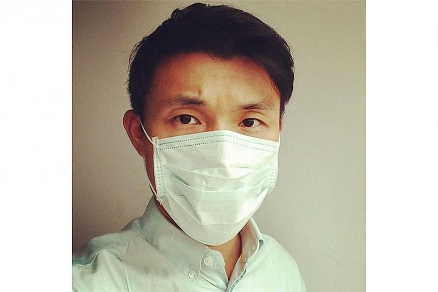 Mr Baey posted a selfie of himself wearing a mask on June 20. The photo was accompanied with a message urging residents to take care during the haze. -- PHOTO BY: BAEY YAM KENG