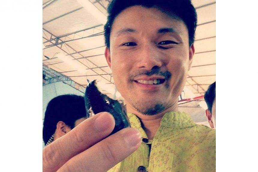 Mr Baey sampled a date at the first ever Tampines Hari Raya Bazaar. -- PHOTO BY: BAEY YAM KENG