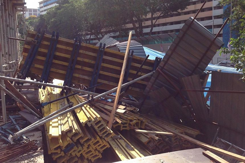 A construction worker was killed on Wednesday morning after the formwork structure he was standing on toppled and fell to the ground.-- ST PHOTO: YEO SAM JO