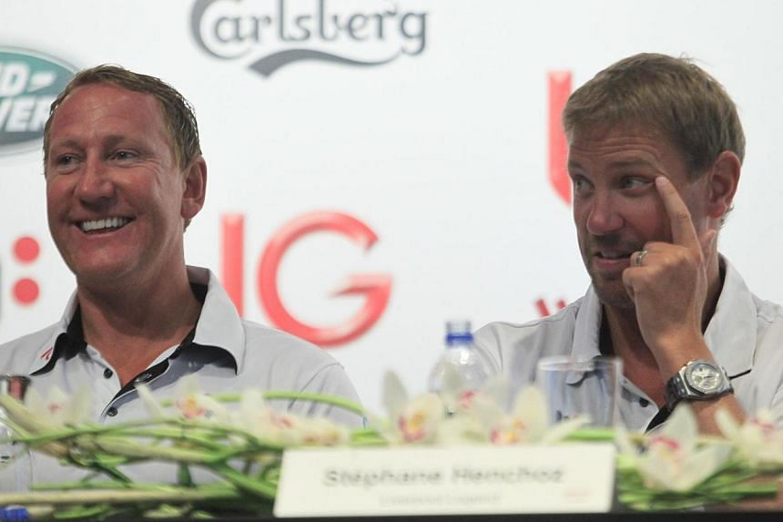 Former EPL stars Ray Parlour and Stephane Henchoz react during a press conference at Marriott Hotel Ballroom III on 14 August 2013.English Premier League favourites from yesteryear will return to Singapore in October for the IG Masters Football