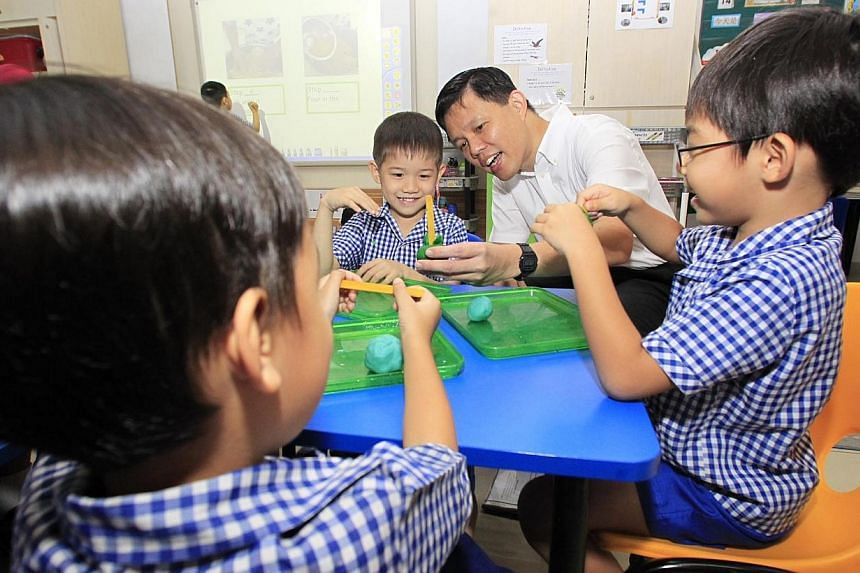 Acting MSF minister Chan Chun Sing joins five-year-old Ryan Tan in making an ice-cream with plasticine during his interaction with the kids at Far Eastern Kindergarten on Aug 14 2013. A suite of support schemes will be rolled out for non-anchor opera