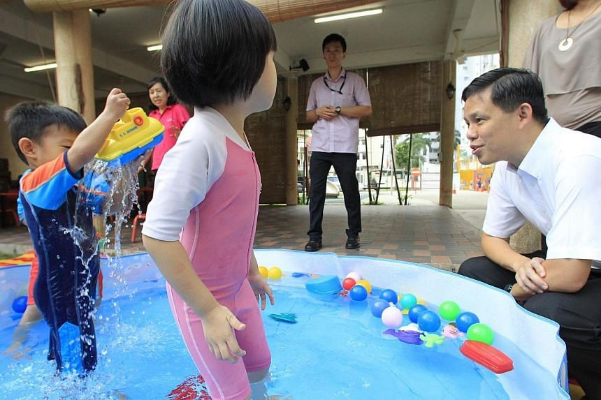 Acting MSF minister Chan Chun Sing interacting with the kids playing in a fun pool at Far Eastern Kindergarten on Aug 14 2013. A suite of support schemes will be rolled out for non-anchor operator pre-schools which receive little or no government gra