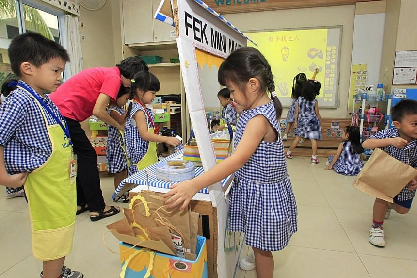 Kids role-play a supermarket experience in the classroom at Far Eastern Kindergarten on Aug 14 2013. A suite of support schemes will be rolled out for non-anchor operator pre-schools which receive little or no government grant. -- ST PHOTO: KEVIN LIM
