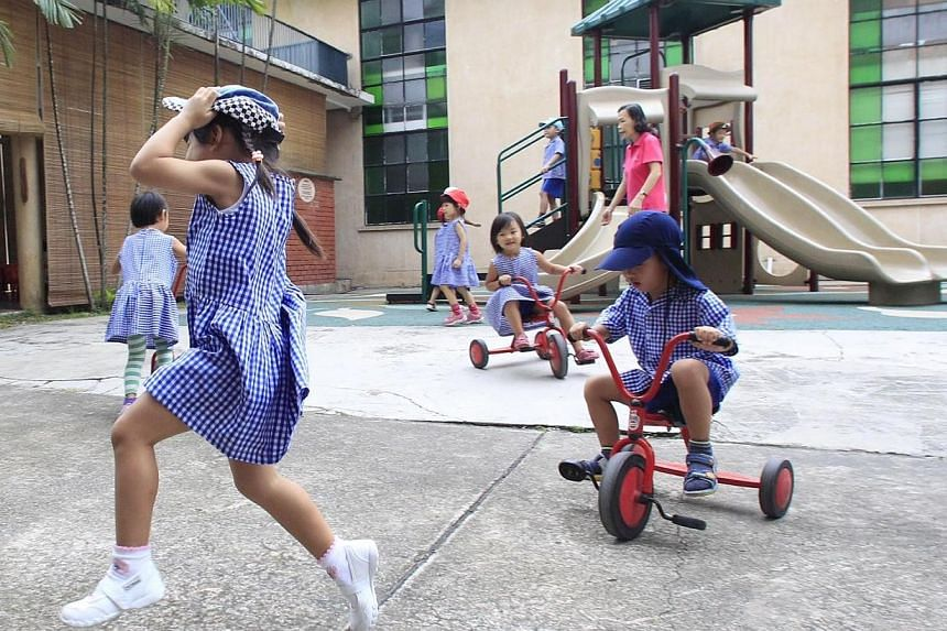 Playtime for kids after a class at Far Eastern Kindergarten on Aug 14 2013. A suite of support schemes will be rolled out for non-anchor operator pre-schools which receive little or no government grant. -- ST PHOTO: KEVIN LIM