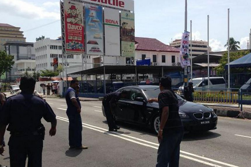Police officers inspecting the car of Mr K. Veerappan in Penang where he was killed in a shooting. A recent spate of violent crimes in Malaysia has not put Singaporeans off going there. However, many are playing it safe, The Straits Times has found.