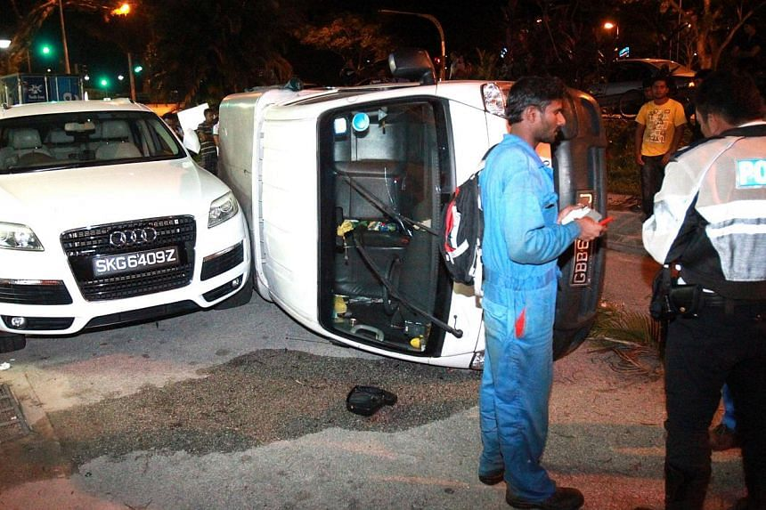 The driver of a white lorry, Mr Ramli Akbar, was arrested after his vehicle swerved across four lanes on Sembawang Road before hitting a tree, tipping over and crashing into an Audi sedan on Monday night. A pill found on the driver has been sent to t