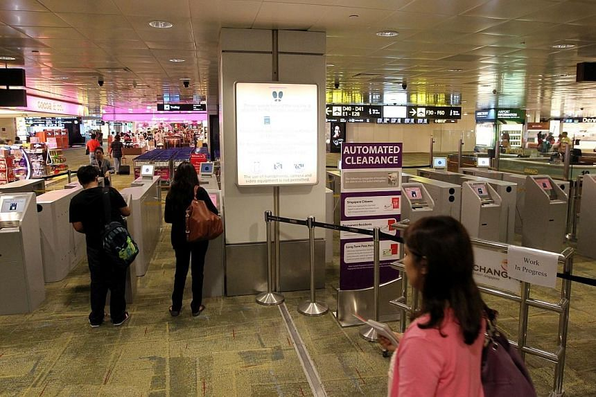 Automatic passport lanes at the departure hall in Changi Airport. With the September school holidays coming up, the Immigration and Checkpoints Authority (ICA) has reminded Singapore citizens planning to travel to ensure that their passports hav
