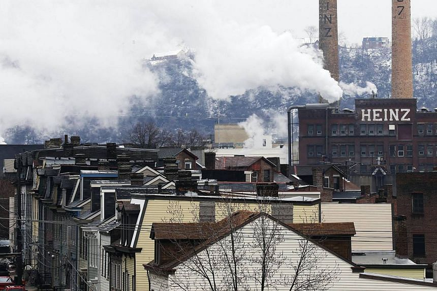 The former Heinz factory, now home to loft apartments, looks over Pittsburgh Pennsylvania's North Side in this file photo taken on Feb 14, 2013. HJ Heinz Co, the world's largest ketchup maker, said on Tuesday it plans to eliminate 600 jobs across Nor